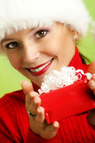 smiling woman with a christmas gift