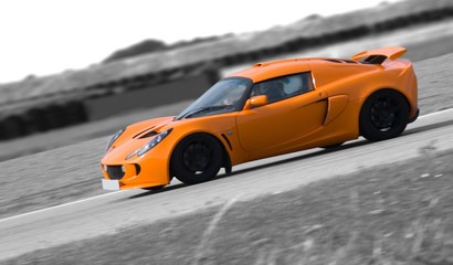 Bright orange sports car on a black and white background