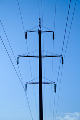 High-voltage electric pylon on background of blue sky