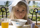 Little girl has a breakfast in the open air   poster