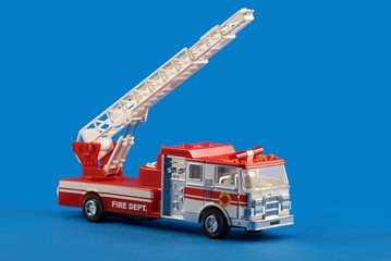 Fire dept car toy on blue