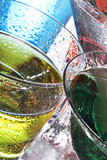 Colorful drinks on a reflective tabletop. poster