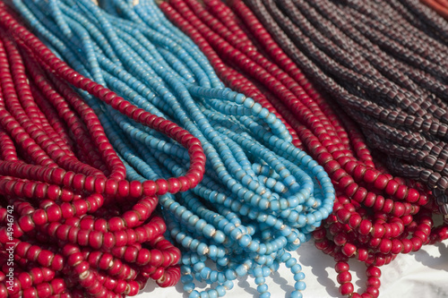 Strands of torquoise, red and brown beaded necklaces