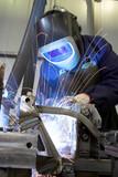 Welder welding with acetylene arc poster