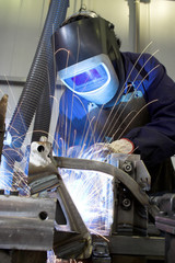 Welder welding with acetylene arc