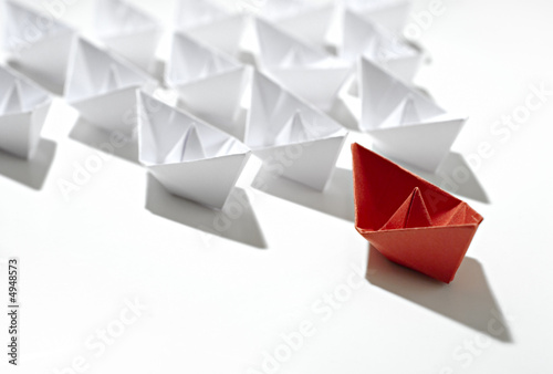 Leinwanddruck Bild isolated leader paper ship