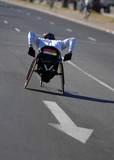 Single wheelchair athlete in action during a marathon. poster