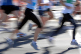 Groups of marathon runners in action poster