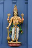 Statue of  Vishnu on Hindu temple poster