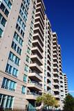 modern condominium apartment building, deep blue sky poster