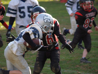 Young football player running with the ball