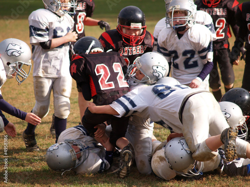 Football players tackling