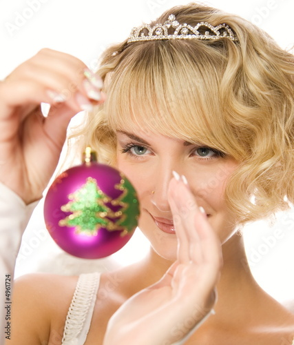 Beautiful blond girl with Christmas-tree decorations (shallow Do