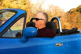 Middle-aged Man in a Blue Convertible poster