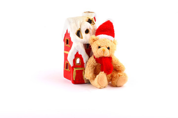 santa teddy bear and red house