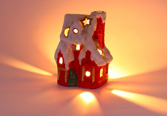 tiny red xmas house and candlelight