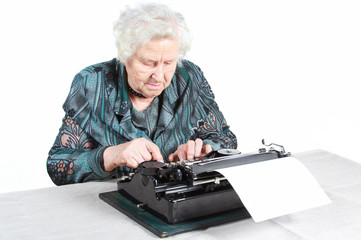 Grandmother with antique typewriter