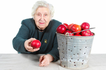 Grandma with red apples.