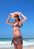Sexy Woman in Bikini Adjusting hat - Fine Art prints
