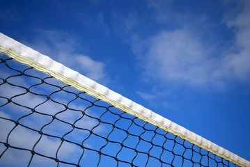 tennis net under blue sky