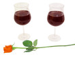 Romantic dinner for two, two glasses of red wine and a rose