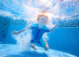 Young boy underwater in swimming pool