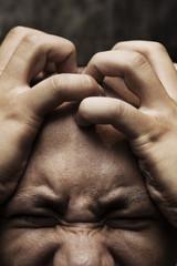 man having painful headache