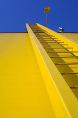 Yellow ladder, stairway or stairway up to the blue sky