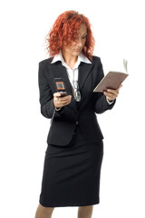 business woman with cell phone and notebook