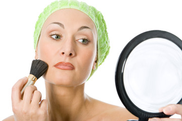 beauty spa woman applying make up in towel