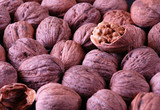 background with walnuts and one crushed walnut poster