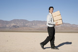 Businessman carrying boxes poster