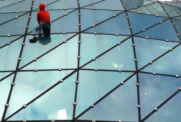Climber on glass roof