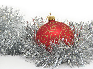 Red christmas ball and silver tinsel