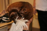 bride hair up wedding feather hairstyle brown