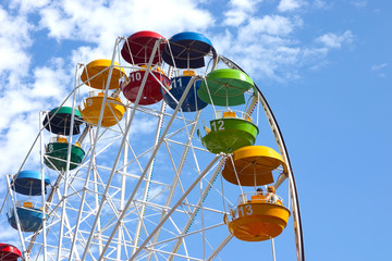Popular attraction in park - a Ferris wheel