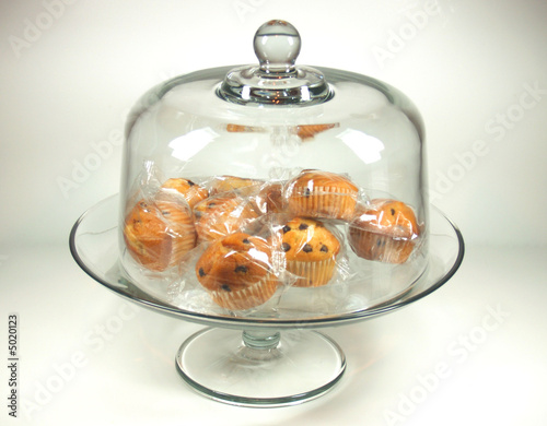 Individully wrapped choclate chip muffins on cake stand