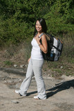 Woman ouotside on a hike with a backpack poster