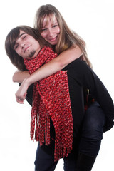 handsome guy with red scarf holds beautiful girl