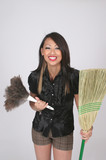 Happy woman with feather duster and broom for housework poster