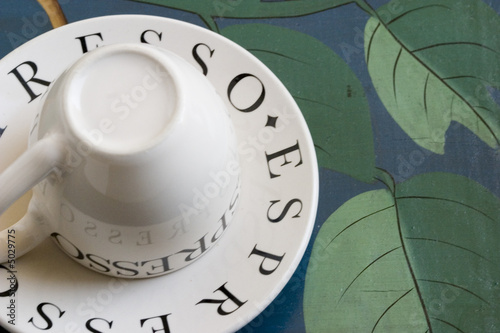espresso cup and saucer on a painted serving tray