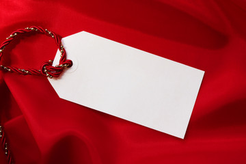 Gift Tag on Red Satin