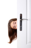 Girl peeking behind the door