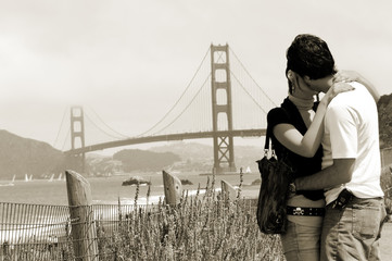 Young couple with Golden Gate bridge, San Francisco
