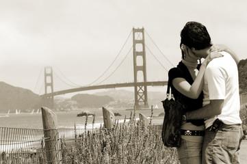 Young couple with Golden Gate bridge, San Francisco