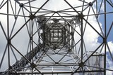 metal structure of antenna mast under sky with clouds poster