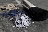 Powder makeup and brush on granite  poster