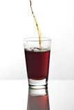 Pouring a glass of dark beer on reflective tabletop poster