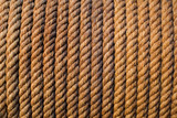 Natural background of coiled rope in old workshop poster