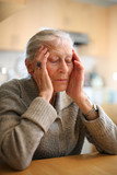 Senior woman relaxing to end headache. Shallow DOF. poster